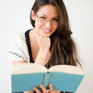 Woman with Reading glasses Maple Grove Eye Doctors at Pearle Vision