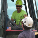 Heavy machine operator wearing sunglasses maple Grove Eye Doctors at Pearle Vision