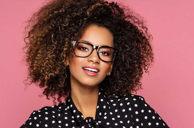 Designer Eyeglass Frame on Female . Maple Grove Eye Doctors at Pearle Vision