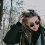 Girl wearing sunglasses in Winter Maple Grove Eye Doctors at Pearle Vision