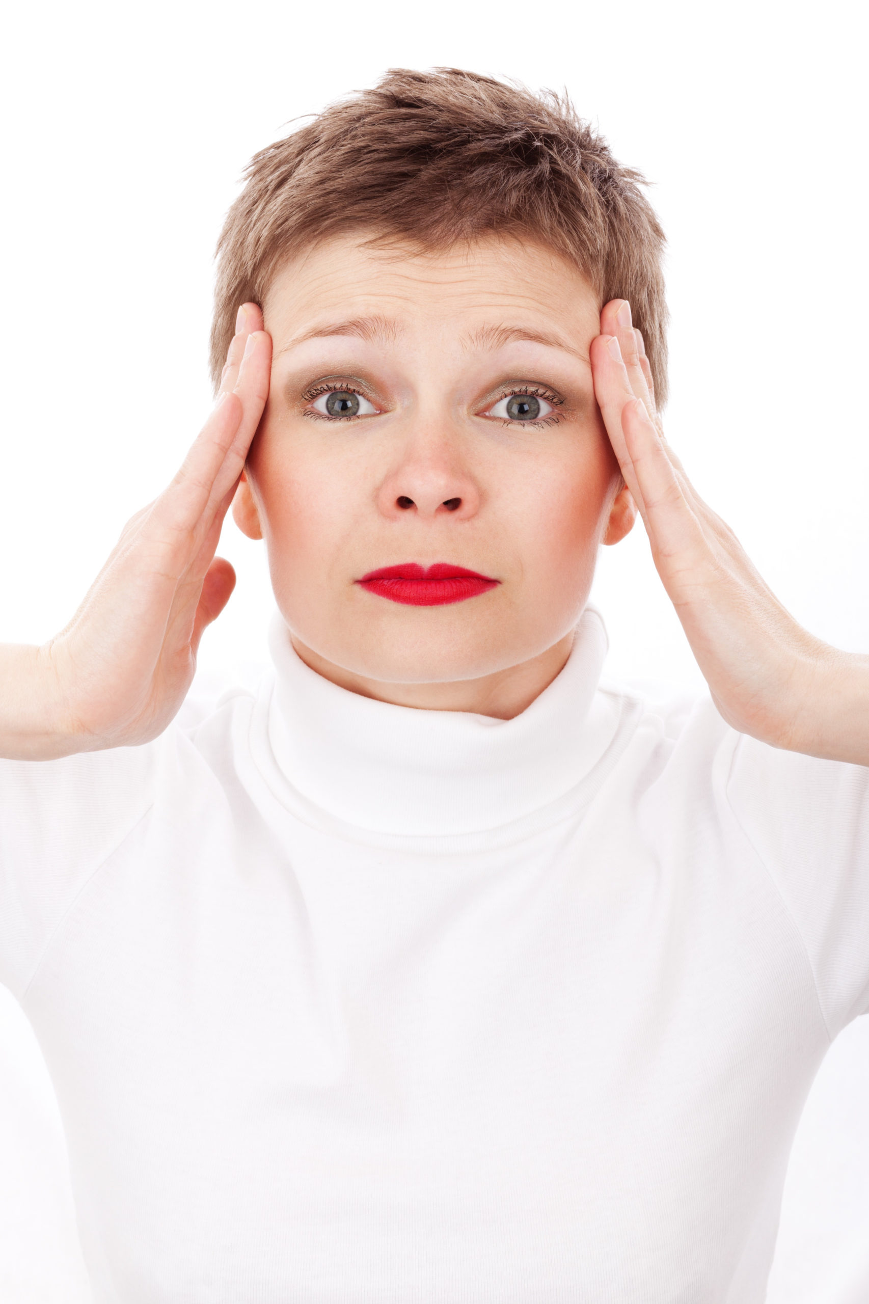 woman with headache. Maple Grove Eye Doctors at Pearle Vision
